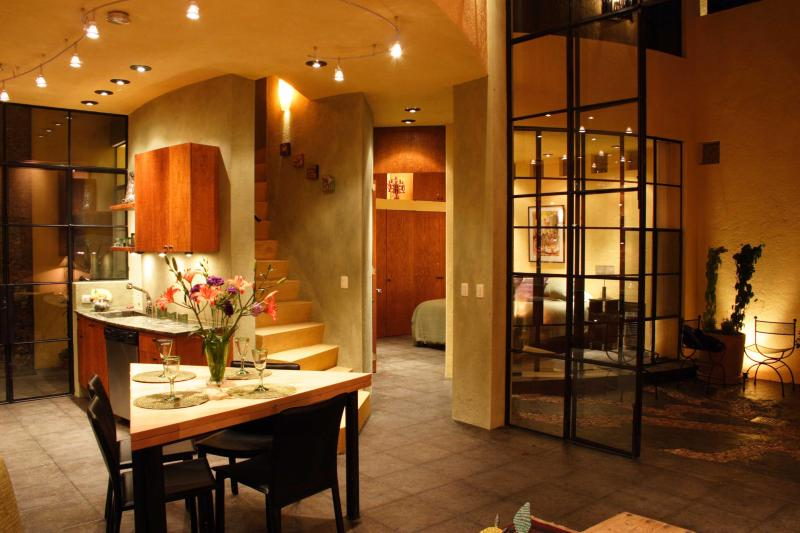 Dining Room and Kitchen at Night - Elegant San Miguel Centro Home, Sweeping Views - San Miguel de Allende - rentals