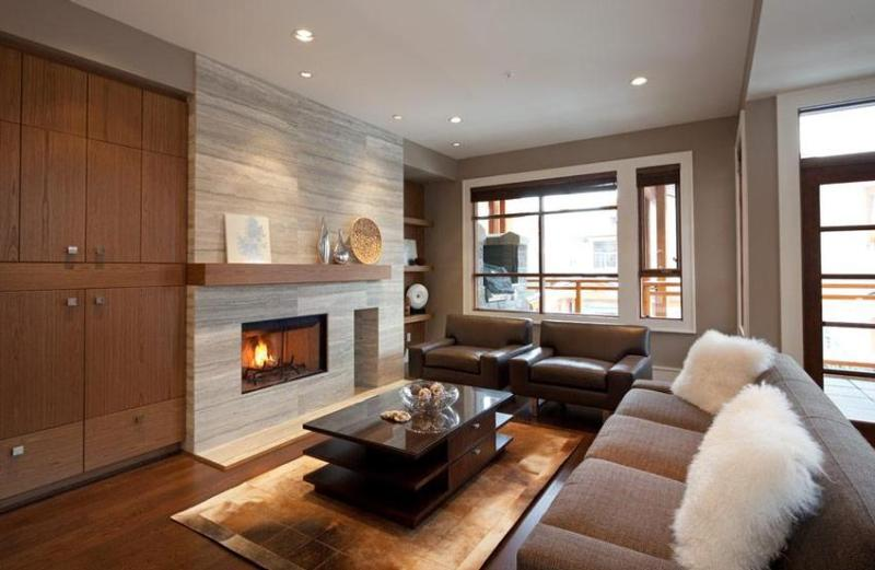 Large open concept living area with a wood burning/ gas assisted fireplace - Deluxe 4 bedroom Whistler Townhome - Whistler - rentals
