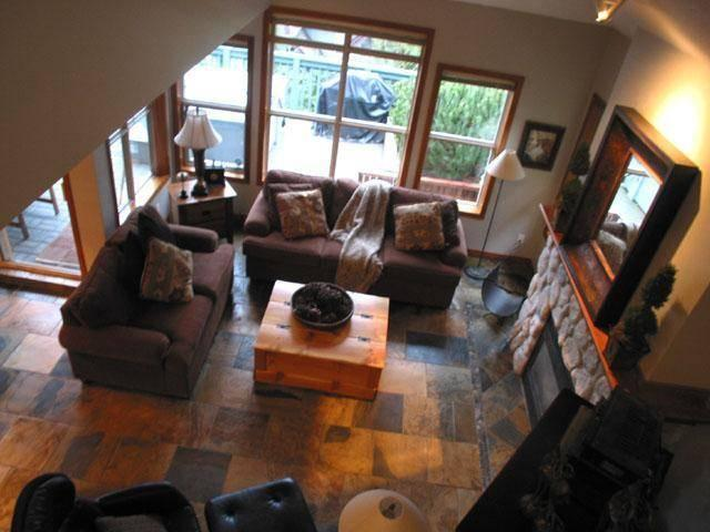 Livingroom with gas fireplace, heated slate floors, large flat screen TV, DVD, ipod dock, 5 disc stereo, plus a huge movie library, and more! - Whistler SlopeSide - Whistler - rentals