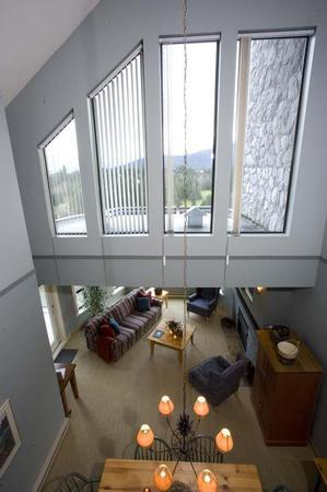 Looking down from the loft to our Living Room and Dining Room. Enjoy the spectacular views of Blackcomb,Wedge Mountain and the Arnold Palmer Golf Course - David and Kathleen Tapping - Whistler - rentals