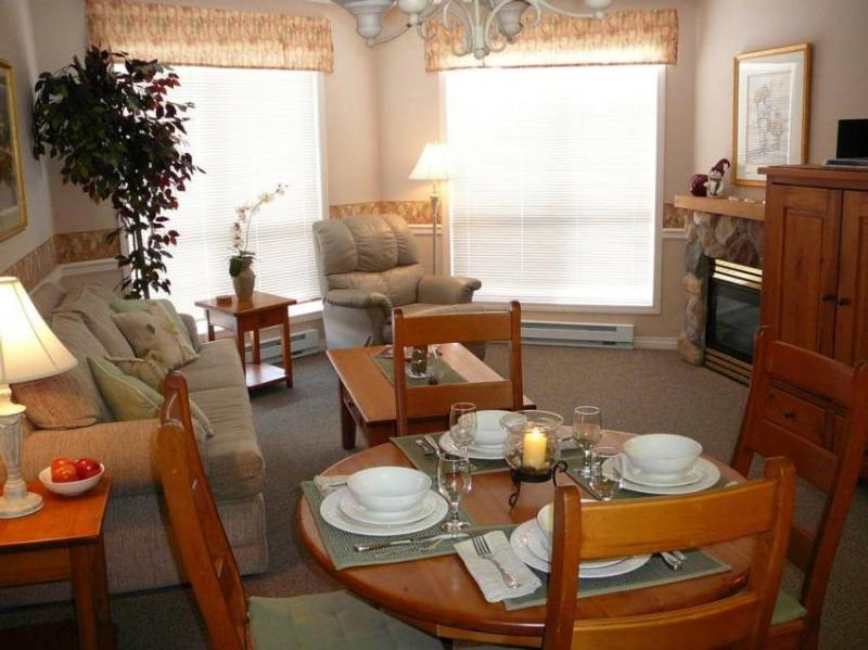 Tastefully appointed and inviting Living and Dining areas with large view windows, cozy, romantic fireplace and entertainment center. - Dwight Yanaga and Cindi White-Yanaga - British Columbia - rentals