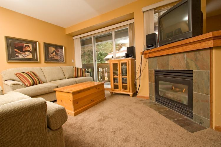Living room with pull-out sofa, entertainment area and fireplace. Access to deck and bbq as well. Please view our photo gallery for additional pictures of the property. - Luxury condo close to everything but very quiet - Whistler - rentals