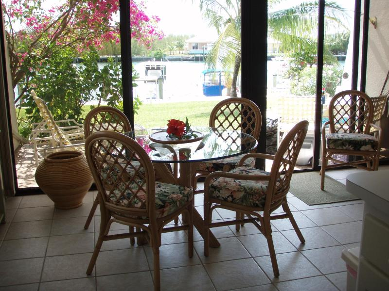 dining with a view - Abaco Condo, boat slip, Treasure Cay, ground level - Treasure Cay - rentals