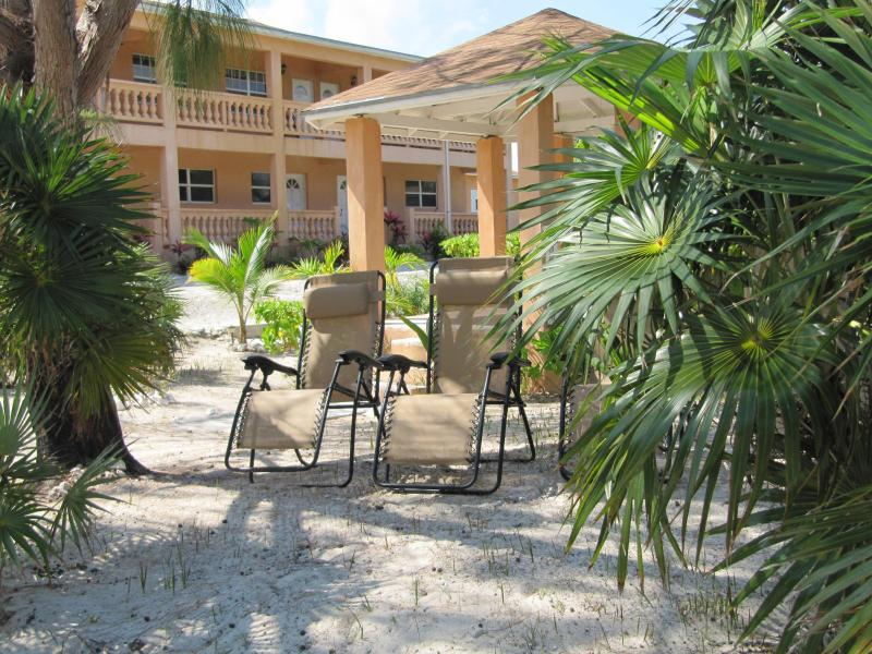 Cedar Palm Suites overlooking the gazebo and beach lounge chairs - Paradise found! Watch the whales from our balcony. - Whitby - rentals
