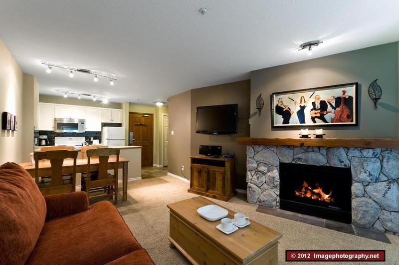 This a beautifully decorated, fully equipped apartment. Looking into the kitchen from the living room. Behind you are large windows that look out over West Coast trees. The sofa bed is in this room. - The Aspens: Ski In/Out, Hot tubs, Pool, Front Desk, Boutique Hotel Quality - Whistler - rentals