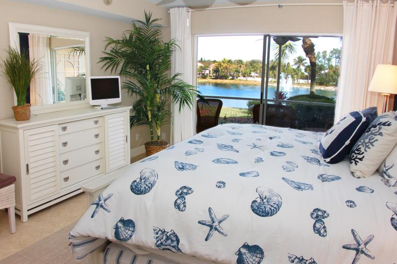 Luxurious pillow top king bed in master bedroom overlooking Hidden Lake. - Falling Waters Pristine Lakefront Condo - Naples - rentals