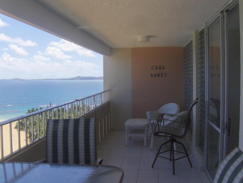 Balcony - looking east - 1 bedroom condo oceanfront 19th FL w/large balcony - Luquillo - rentals