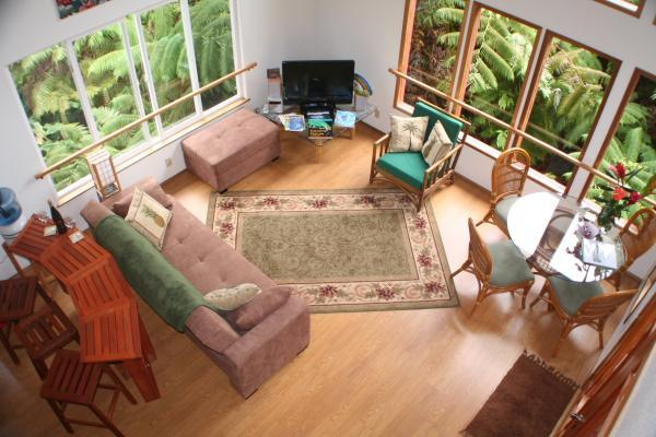 From the loft down a fold out full sized convertable sofa and teak breakfast bar - Kilauea Rainforest Retreat - Volcano - rentals