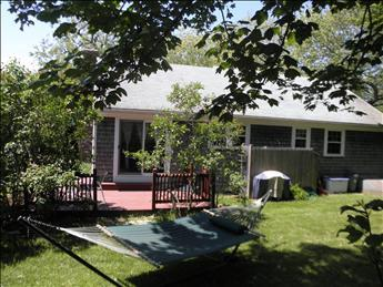 Back Yard view, deck, grill, outdoor dining and hammock for your relaxing vacation - Yarmouth Vacation Rental (100474) - Yarmouth - rentals