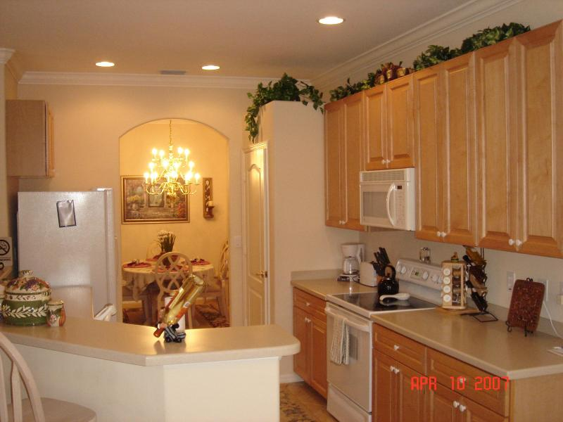 Kitchen area with bar - Rookery Pointe  - The Perfect Place To Nest - Estero - rentals