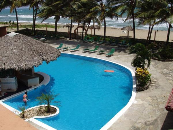 OVER VIEW OF POOL / BEACH - CARIBBEAN BEACHFRONT CONDO ONLY $1050 PER MONTH !! - Cabarete - rentals