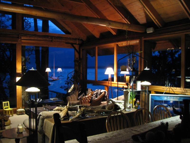 Inside the living room in the Longhouse, this is an outdoor post & beam living area + dining for 10 - Westcoast Oceanside Retreats&Cottages Pets welcome - Halfmoon Bay - rentals