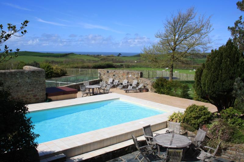 Sea view beyond the pool and tenis court from The Annex - Panoramic sea views with pool, tennis & hot tub - Bideford - rentals