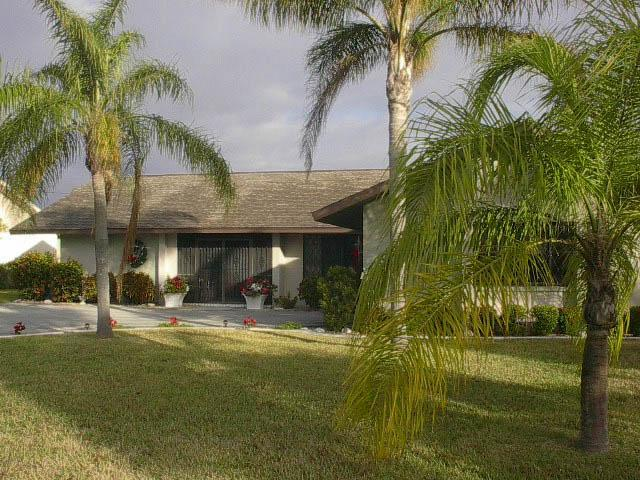 Front of home with side car gargage - Sailboat Access Pool Home Just Minutes to the Gulf - Cape Coral - rentals