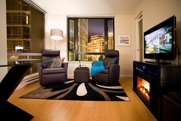 Cozy Living Area with Fireplace by Night - Elegance and Comfort Abound in this 1BR Condo - Victoria - rentals