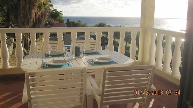 Dinning on our balconey views to St.Barts - Saint Martin Luxury Condo, Dawn Beach Ocean Views - Dawn Beach - rentals