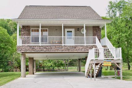 Rustic River Retreat has covered parking and a great view of the Little Pigeon River - Rustic River Retreat - Pigeon Forge - rentals