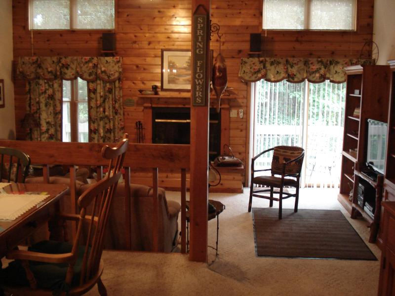 Welcome! Two-Story Sunken Great Room at Dusk; View of Trees from Private Deck - Executive Bear Retreat: Spa HDTV  WiFi  Pool Golf - Shawnee on Delaware - rentals