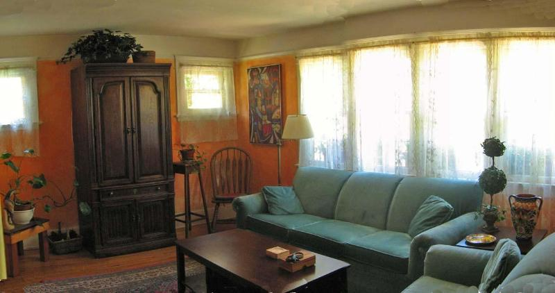 Living room from entry hall, with two couches and entertainment center. - 2 BR Tuscan Cottage in Monet Gardens - Venice Beach - rentals