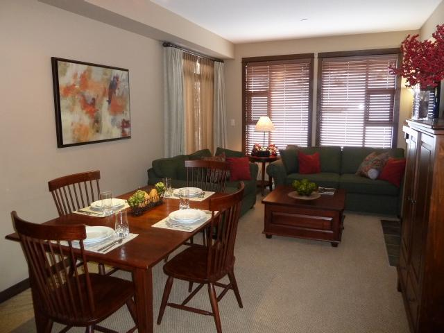 Dining room (table can expand to accommodate six people) opens into the living room. Living room opens onto the outside deck and hot tub. - Our Northern Paradise - Sun Peaks - rentals