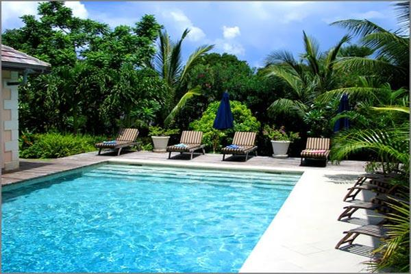 Designed to take advantage of passing trade winds, this villa is surrounded by a tropical garden. RL LIM - Image 1 - Barbados - rentals