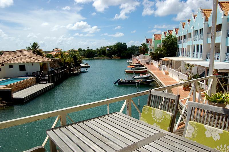 Dining on your waterfront terrace - Adorable Affordable Apartment on Water - Pool WiFi - Kralendijk - rentals