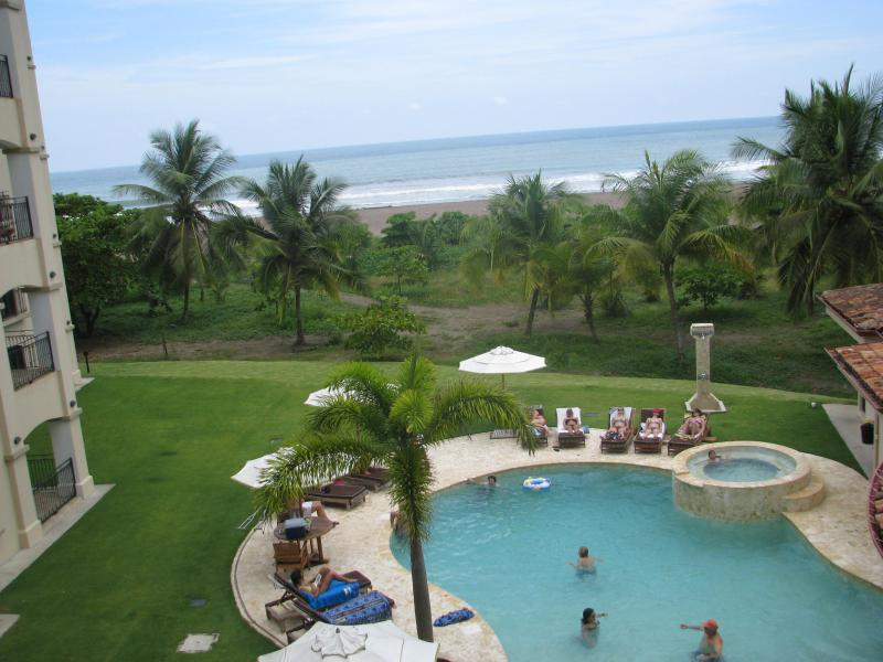 Pool and ocean view from your balcony - Upscale Brand New Beachfront condo 3 B/R - Jaco - rentals