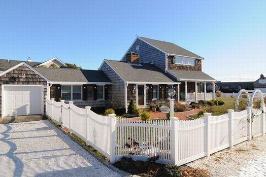 View of the front of the house, drive and fenced in yard. - Luxury Home Just Steps to Sandy Beach - South Yarmouth - rentals
