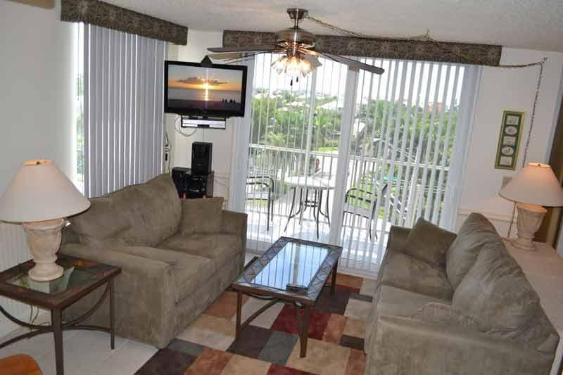 Living Room with Love Seat and Sleeper Sofa - Newly Renovated Gold Rated Condo: Gulf,Tennis,Pool - Florida - rentals