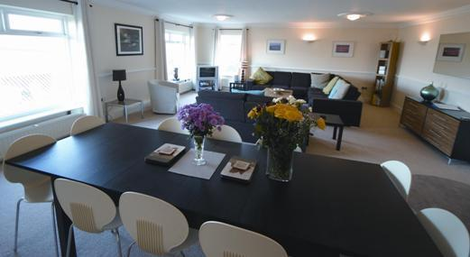 dining area and lounge overlooking Camel estuary - 4 bed first fl apt-great views in Padstow Cornwall - Padstow - rentals