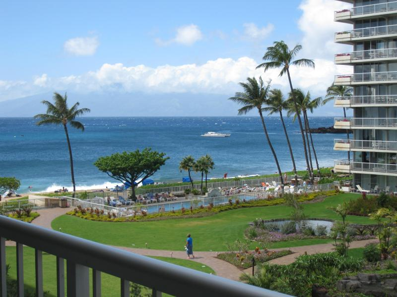 View of the courtyard and ocean from the balcony/lanai - The Whaler on Kaanapali Beach 1BR/2BA condo Maui - Kaanapali - rentals
