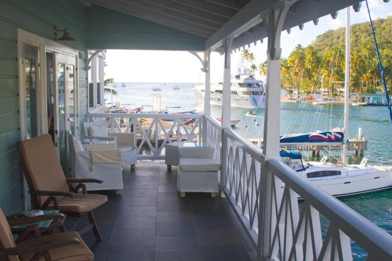 Relax on the wide balcony overlooking the marina and Marigot Bay - Sitting on the dock of the bay...St. Lucia - Marigot Bay - rentals