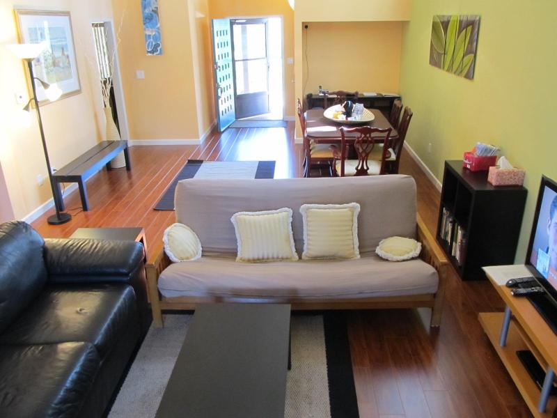 Living and Dining room with high catherdal ceilings, beautiful new floor. - Modern Townhouse in Gated Community, Pool & Tennis - Anaheim - rentals