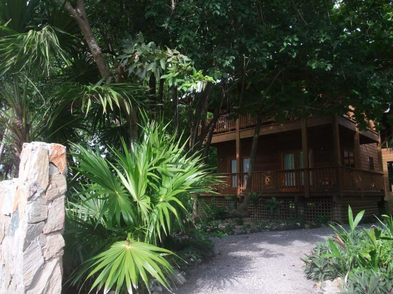 View of Cocolobo Lodge from the street - Cocolobo Resort Lodge A 2BR/2.5BA Fully Furnished - West End - rentals