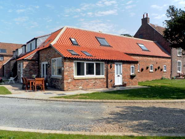 RABBIT HOUSE, pet friendly, luxury holiday cottage, with a garden in Skipsea, Ref 8242 - Image 1 - Skipsea - rentals