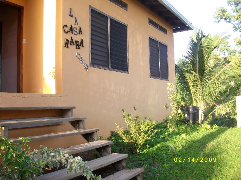 The front door and exterior of the Casa - La Casa Rara Westend  w/ Pool  $100 Spring Special - West End - rentals