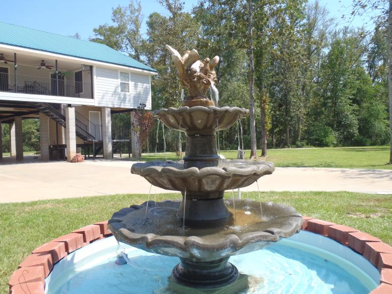 This fountain greets you when you arrive.  Its is in the center of the large circular driveway - SPRING SPECIAL RATES! Pool, Hot Tub, River Luxury - Gulfport - rentals