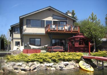 Tandem kayak on private dock with hot tub, balcony, lawn furniture, horse shoe toss & fire pit - Waterfront Safari-Theme Home, Dock, Spa, Bikes Dog - South Lake Tahoe - rentals
