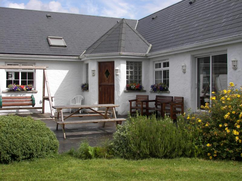 Dine Alfresco on the sunlit patio - Charming Country House Near Scenic Westport Town - Westport - rentals
