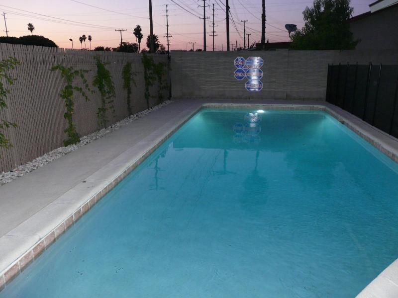 Private heated swimming pool with child safety fence - Only .5 miles to the free Disney tram, Remodeled Home Across Disney With Private Fenced Heated Pool* - Anaheim - rentals