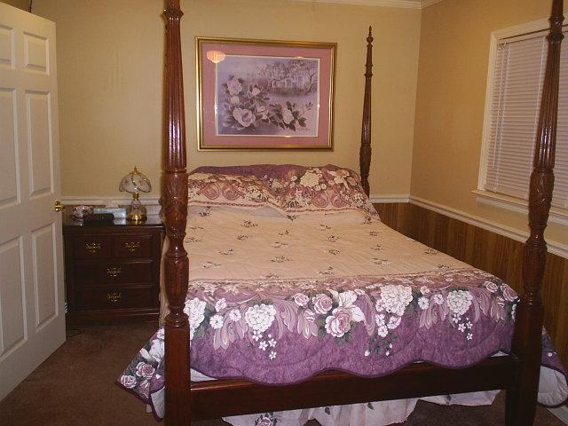 Bedroom with Queen four post rice bed has matching large dresser - Roomy 1 BR cottage house in Surfside Beach - Surfside Beach - rentals