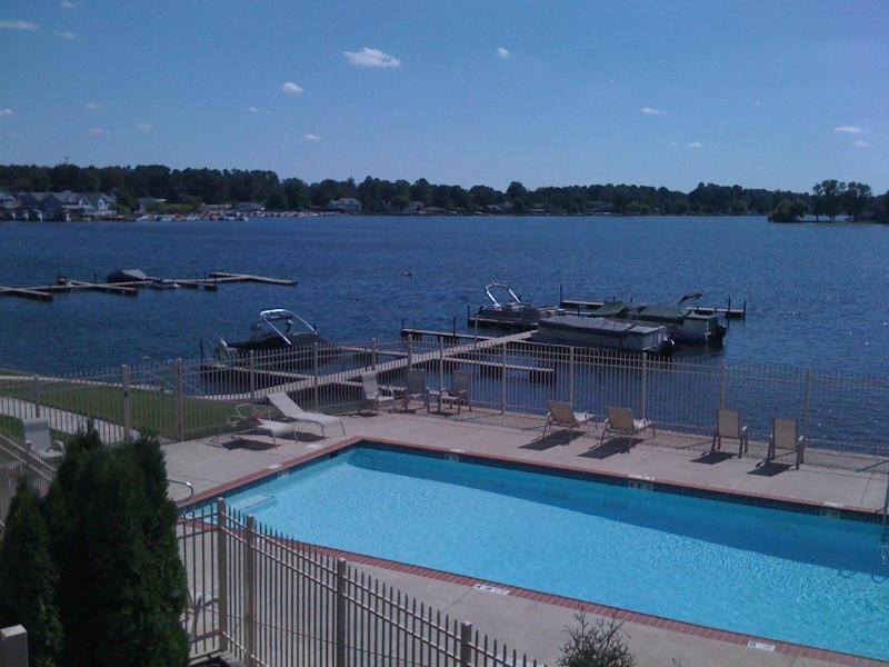 View from upstairs Living Room windows overlooks the pool and sparkling Pine Lake beyond. - Luxury Lakefront Condo, Pool, Dock, Golf, Casino - LaPorte - rentals