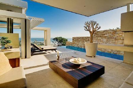 Modern Tranquil Skies- superb ocean views, pool & koi pond, near beach - Image 1 - Camps Bay - rentals