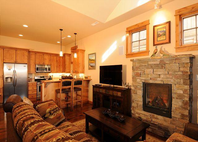 Living room with a cozy fireplace and flat screen tv - Bridger Bungalow - Bozeman - rentals