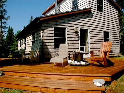 Clad in natural cedar shingles, Bramble Lane Cottage by the Sea harmonizes beautifully with its wooded oceanfront setting. - Bramble Lane by the Sea, S. Shore, Nova Scotia - Lockeport - rentals
