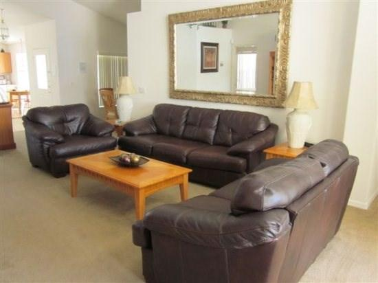 beautiful living room looking out to the pool - Indian Creek Beauty, only 2.5 miles to the Disney Entrance - Kissimmee - rentals