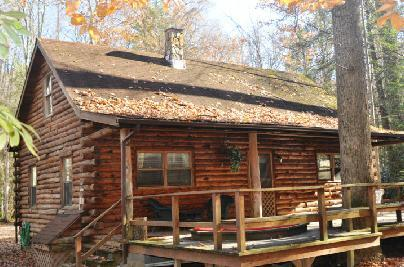 Large deck with tree - Shavers Fork Riverfront Log Cabin - The Big Poplar - Elkins - rentals