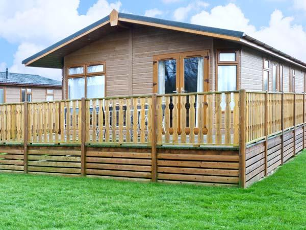 GRESSINGHAM TWO, pet friendly, country holiday cottage, with pool in South Lakeland Leisure Village, Ref 12262 - Image 1 - South Lakeland Leisure Village - rentals
