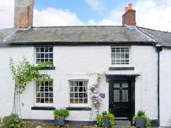 DARWIN COTTAGE, pet friendly, character holiday cottage, with open fire in Llansilin, Ref 11215 - Image 1 - Oswestry - rentals