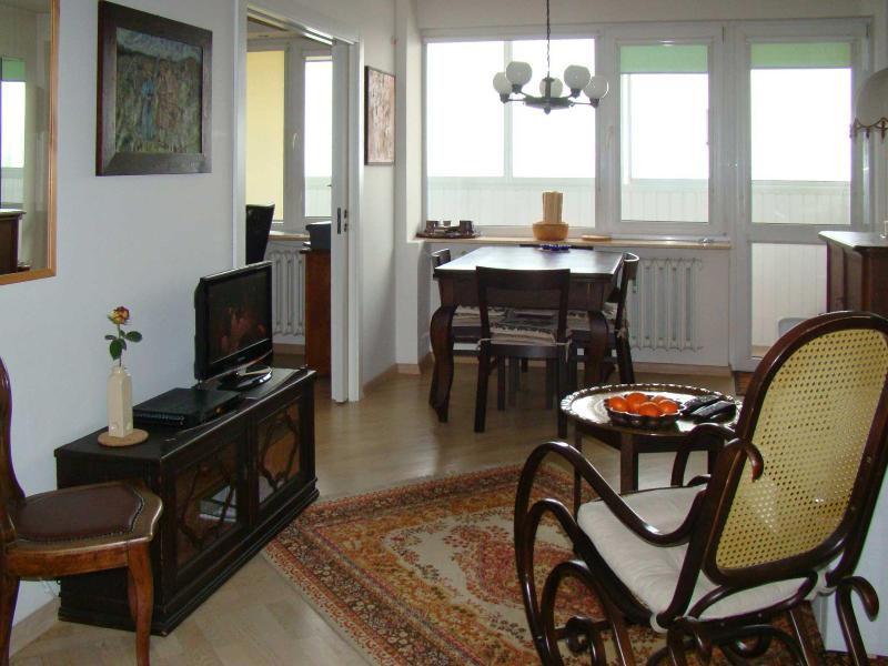Living/dining looking towards balcony - Home Away From Home with Panoramic View of Warsaw - Warsaw - rentals